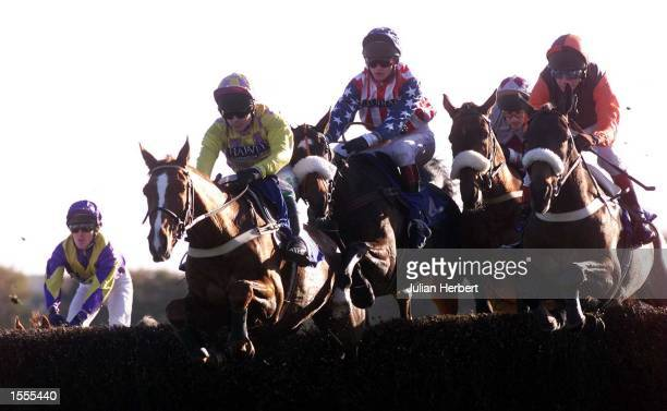 Joe Tizzard and Flagship Uberalles clear the first fence at Exeter before going on to win The William Hill Haldon Gold Cup Steeple Chase Race...