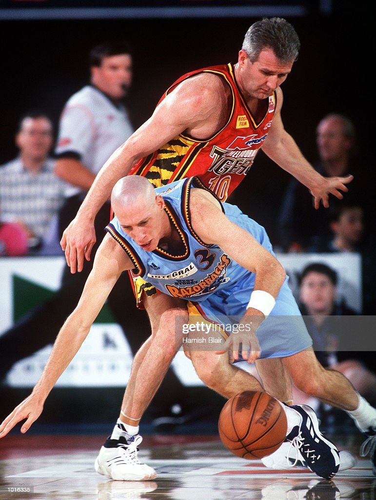 John Rillie of West Sydney goes to ground under pressure from Andrew Gaze of Melbourne, during the game between Melbourne and West Sydney at Melbourne Park, Melbourne, Australia. Melbourne defeated West Sydney 103 - 97. Mandatory Credit: Hamish Blair/ALLSPORT