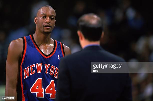 John Wallace of the New York Knicks talks with his Coach during the game against the Denver Nuggets at the Pepsi Center in Denver Colorado The Knicks...