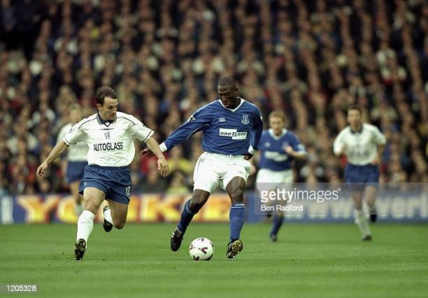 Kevin Campbell of Everton takes on Albert Ferrer of Chelsea during the FA Carling Premier League match played at Goodison Park in Liverpool England...