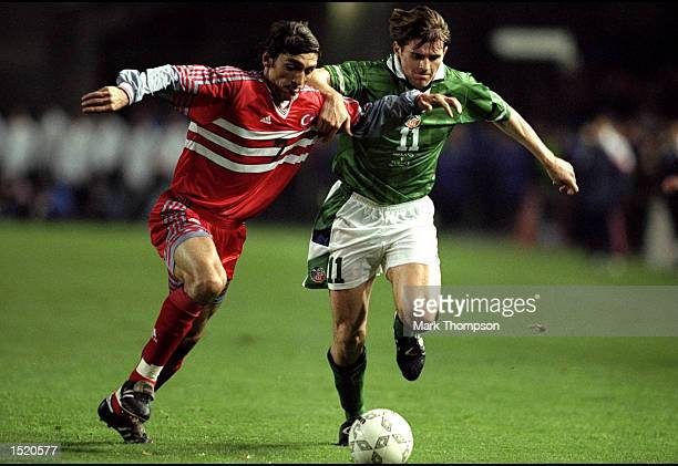 Kevin Kilbane of Ireland battles with Tayfun Korkut of Turkey during the Euro 2000 Playoff First Leg match played at Landsdowne Road in Dublin...