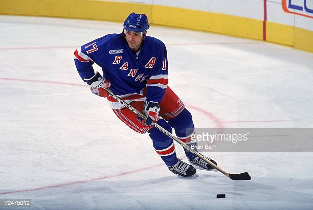 Kevin Stevens of the New York Rangers controls the puck during a game against the Colorado Avalanche at the Pepsi Center in Denver Colorado The...