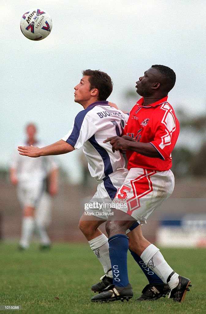 Melbourne Knights Ramsford Banini #15 and Newcastle Breakers John Buonavoglia #10 fight for the ball, during the second half of the NSL game played at Knights Stadium, Melbourne, Victoria, Australia. Mandatory Credit: Mark Dadswell/ALLSPORT