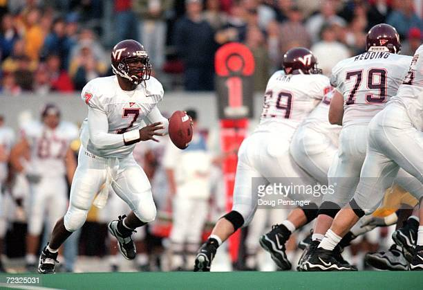 Michael Vick of the Virginia Tech Hokies looks to pass the ball during a game against the West Virginia Mountaineers at Mountaineer Field in...