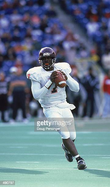Michael Vick of the Virginia Tech Hokies passes the ball during a game against the Temple Owls at the Veterans Stadium in Philadelphia, Pennsyvania....