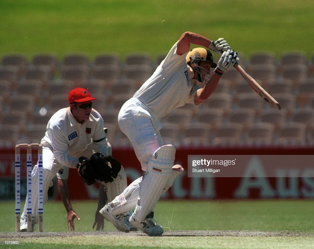 Mike Hussey, batsman for Western Australia, plays a drive during day two of the Pura Milk Cup Match played between South Australia and Western Australia at the Adelaide Oval. Hussey was out for 67 runs. Mandatory Credit: Stuart Milligan/ALLSPORT