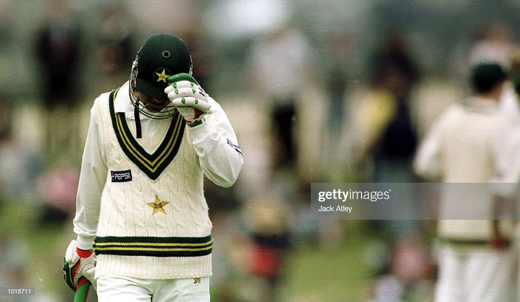 Moin Khan of Pakistan walks back to the dressing rooms after being caught out by Glenn McGrath off the bowling of Scott Muller, on the first day of the of the second test match between Australia and Pakistan at Bellerive Oval,Hobart, Tasmania. Mandatory Credit: Jack Atley/ALLSPORT