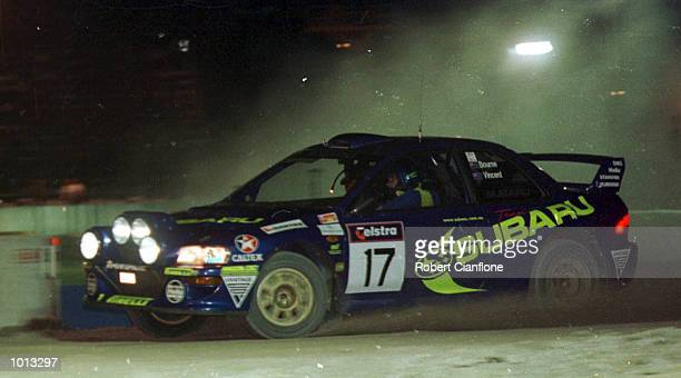 Possum Bourne of New Zealand drives his Subaru Impreza around the Langley Park Super Stage during th first round of the Rally Of Australia Perth...