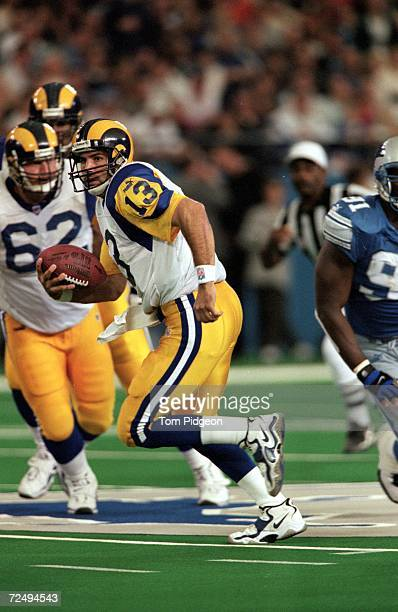 Quarterback Kurt Warner of the St Louis Rams runs with the ball against the Detroit Lions at the Pontiac Silverdome in Pontiac Michigan The Lions...