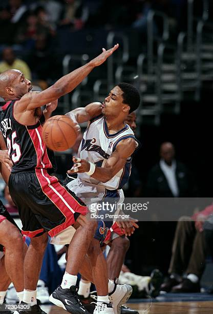 Rod Strickland of the Washington Wizards passes the ball as Anthony Carter of the Miami Heat tries to block him during the game at the MCI Center in...