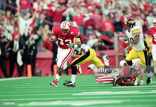 Ron Dayne of the Wisconsin Badgers carries the ball for a 32yard gain for a NCAA record during the game against the Iowa Hawkeyes at the Camp Randall...