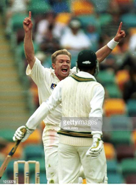 Scott Muller of Australia celebrates his first Test wicket as Abdur Razzaq of Pakistan is caught by Mark Waugh during the second days play of the...