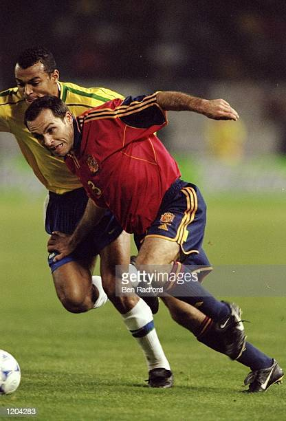 Sergi Barjuan of Spain takes on Cafu of Brazil during the International Friendly at the Estadio Balaidos in Vigo Spain The game ended goalless...