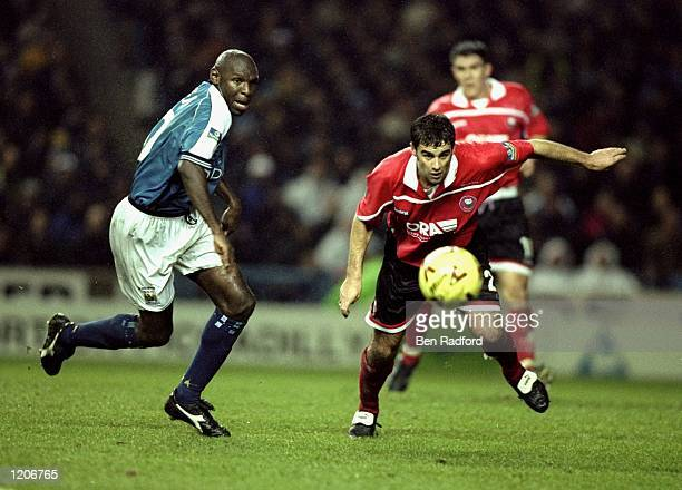 Shaun Goater of Manchester City battles with Chris Barker of Barnsley during the Nationwide Division One match played at Maine Road in Manchester...