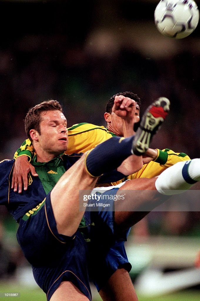 Socceroo forward Mark Viduka manages to get boot to ball ahead of a Brazilian defender during the first half of the Socceroos v Brazil game, played at the MCG, Melbourne, Victoria, Australia. The match was drawn 2-2. Mandatory Credit: Stuart Milligan/ALLSPORT