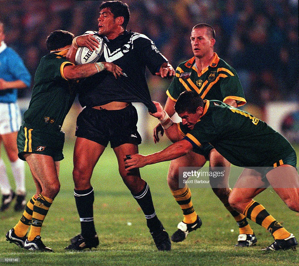 Stephen Kearney of New Zealand is tackled by Bryan Fletcher of Australia during the Tri Nations final between Australia v New Zealand at Ericsson stadium,Auckland New Zealand.Australia won 22-20. Mandatory Credit: Scott Barbour/ALLSPORT