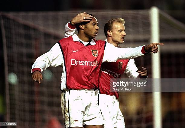Thierry Henry of Arsenal celebrates his goal with team mate Dennis Bergkamp during the FA Carling Premiership match against Derby County at Highbury...