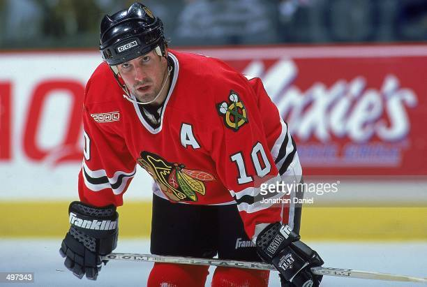 Tony Amonte of the Chicago Blackhawks looks on from the ice during the game against the Calgary Flames at the Canadien Airlines Saddledome in Calgary...