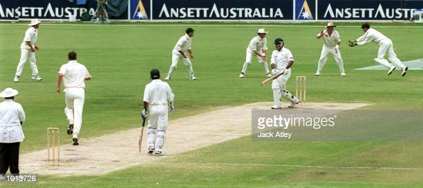 Wicketkeeper Adam Gilchrist of Australia on far right catches Ijaz Ahmed of Pakistan off the bowling of Glenn McGrath for five during the fourth days...