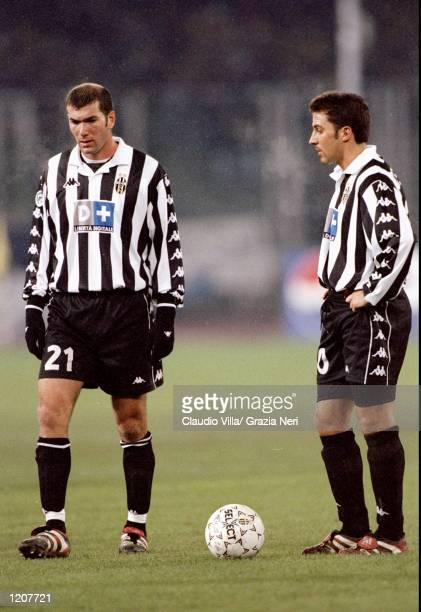 Zinedine Zidane and Alessandro Del Piero of Juventus on the ball against AC Milan during the Italian Serie match at the Stadio Delle Alpi in Turin...