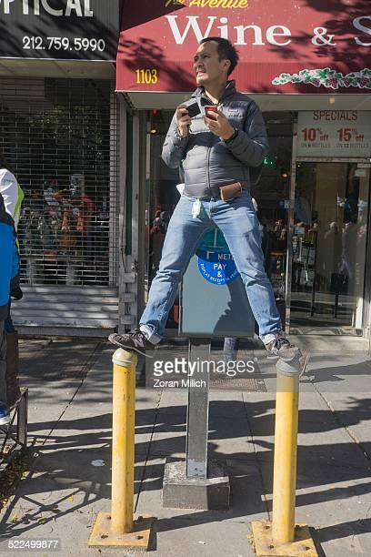 Nov 2 2014 A man photographs the Runners at the New York City Marathon as they reach the 16 mile mark off the Ed Koch Bridge The Manhattan Borough of...