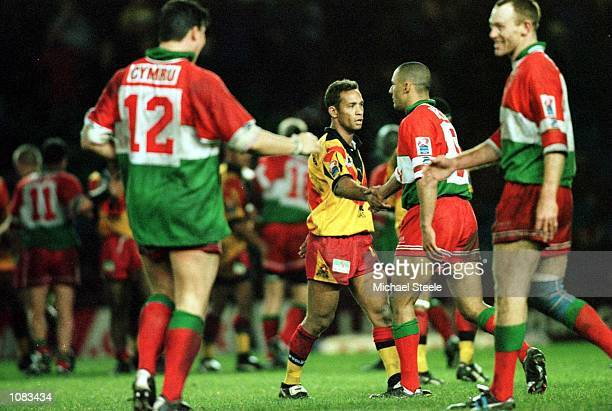 A dejected Adrian Lam of PNG congratulates the Wales players after the Wales v Papua New Guinea QuarterFinal match at the Auto Quest Stadium Widnes...