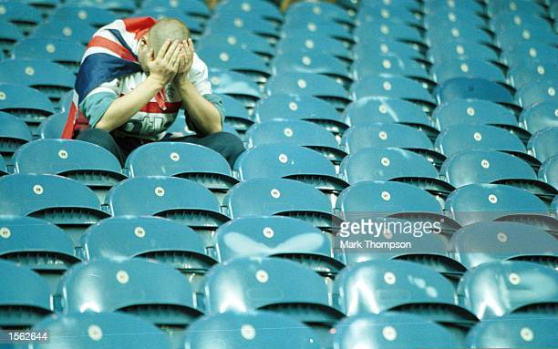 A dejected Rangers fan lholds his head in despair after the Champions League Group D match between Rangers and Monacco played at Ibrox stadium...