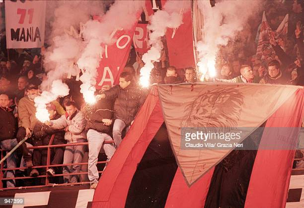AC Milan fans cheer their team on during the Italian Serie A match against Napoli played at the San Siro in Milan Italy AC Milan won the match 10...