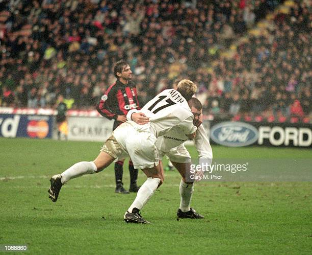 Alan Smith and Dominic Matteo of Leeds United celebrate during the UEFA Champions League match against AC Milan played at the San Siro in Milan Italy...