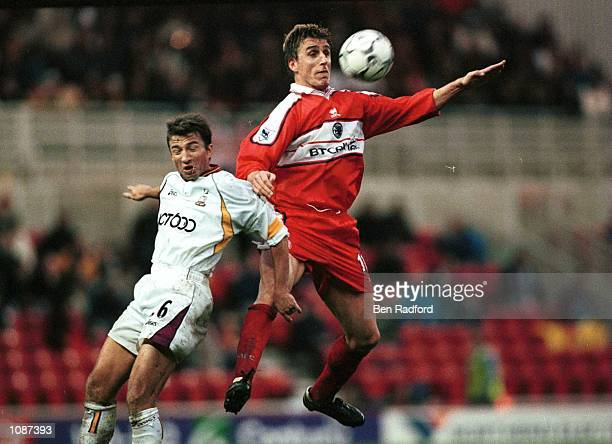 Alen Boksic of Middlesbrough is tackled by Dan Petrescu of Bradford during the FA Carling Premiership match between Middlesbrough and Bradford City...