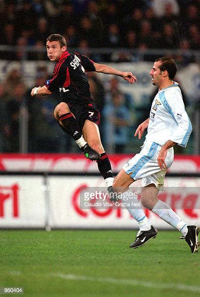 Andrei Shevchenko of AC Milan shoots as Giuseppe Pancaro of Lazio closes in during the Italian Serie A match played at the Stadio Olimpico in Rome...