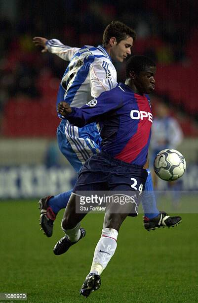 Bernard Mendy of Paris shields the ball from Sanchez Del Amo Victor of Deportivo during the Champions League Group B Match between Paris St Germain...