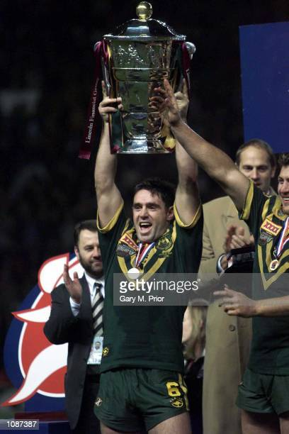 Captain Brad Fittler celebrates with the trophy after winning the Australia v New Zealand Rugby League World Cup Final at Old Trafford Manchester...