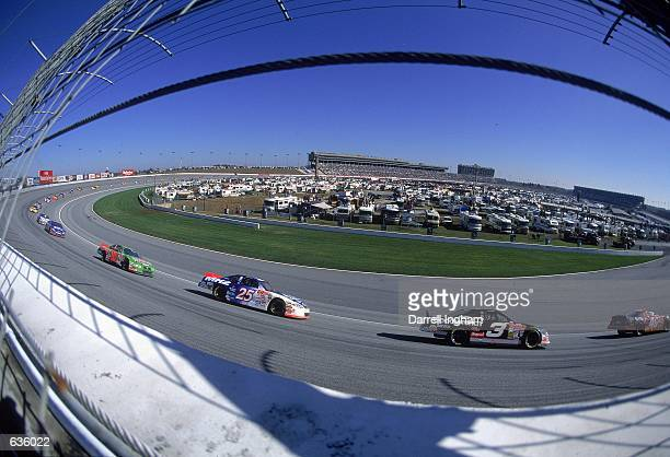 Dale Earnhardt leads Jerry Nadeau and Bobby Labonte around the corner during the Napa 500 presented by NAPA part of the NASCAR Winston Cup Series at...