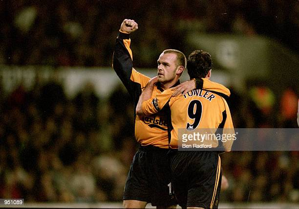 Danny Murphy and Robbie Fowler of Liverpool celebrate during the Worthington Cup fourth round match against Stoke City played at the Britannia...