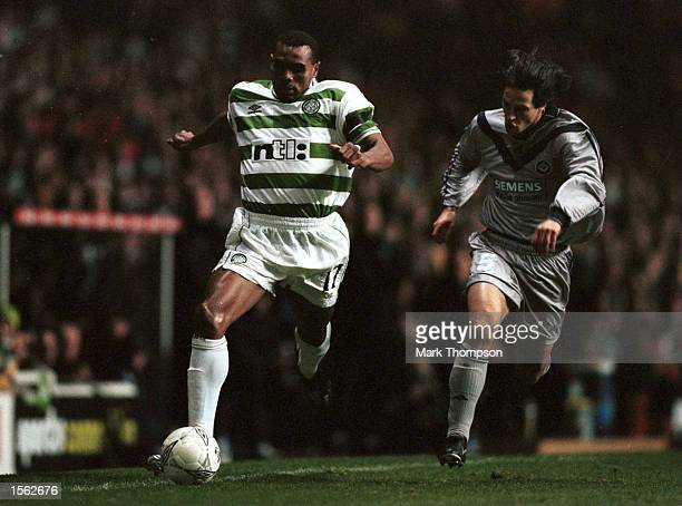 Didier Agathe of Celtic is chased by Jerome Bonnissel of Bordeaux during the UEFA Cup Second Round Second Leg match between Celtic and Bordeaux...