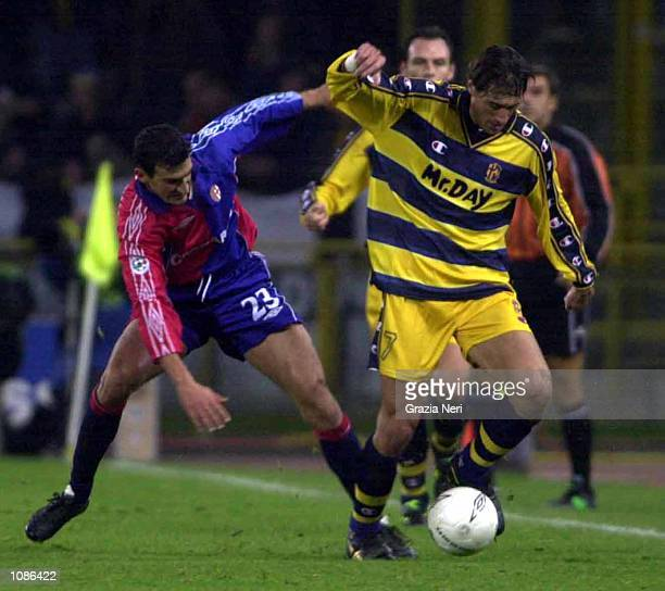 Diego Fuser of Parma and Massimo Tarantino of Bologna challenge for the ball during the Serie A 7th round league match between Bologna vs Parma...