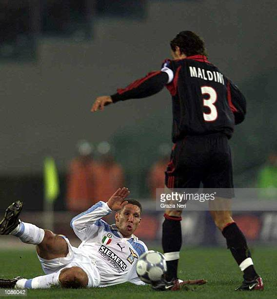 Diego Simeone of Lzio tackles Paolo Maldini of Milan during the Serie A match between Lazio v Milan played at the Olympic Stadium Rome Italy...