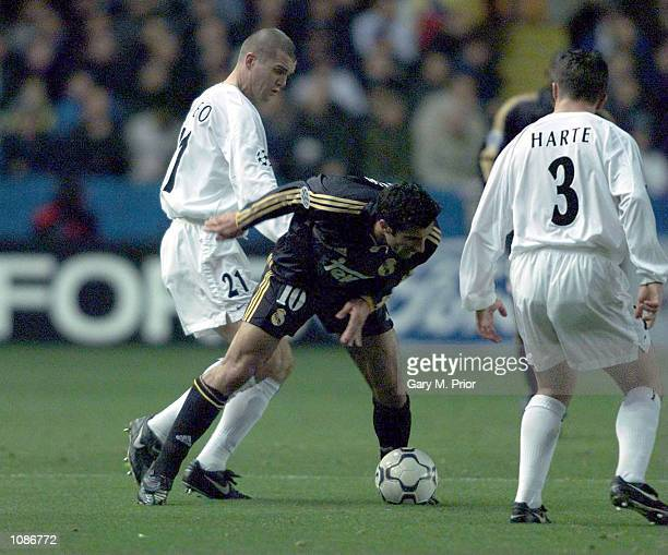 Dominic Matteo of Leeds clashes with Luis Figo of Madrid during the Leeds United v Real Madrid UEFA Champions League Group D match at Elland Road...