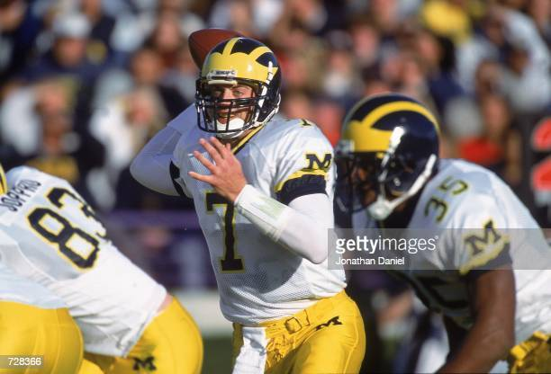 Drew Henson of the Michigan Wolverines pulls back to pass during the game against the Northwestern Wildcats at the Ryan Field in Evanston Illinois...