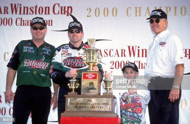 Driver Bobby Labonte poses with Joe Gibbs after winning the Pennzoil 400 part of the NASCAR Winston Cup Series at the Homestead Miami Speedway in...