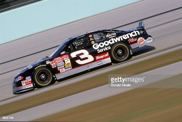 Driver Dale Earnhardt who drives a Chevrolet Monte Carlo for Richard Childress Racing speeds down the track during the Pennzoil 400 part of the...