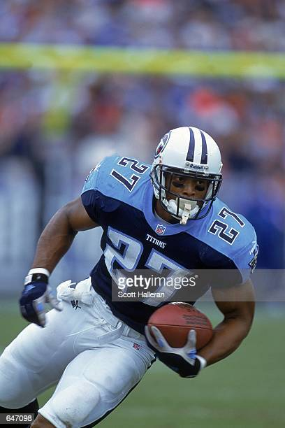 Eddie George of the Tennessee Titans moves with the ball during the game against the Baltimore Ravens at the Adelphia Colisuem in Nashville Tennessee...