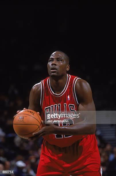 Elton Brand of the Chicago Bulls sets to make a free throw during the game against the Golden State Warriors at the Network Associates Stadium in...