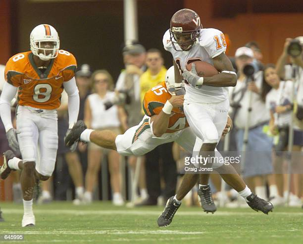 Emmett Johnson of Virginia Tech shakes off Howard Clark of Miami during the first half of the Virginia Tech versus Miami game at the Orange Bowl in...