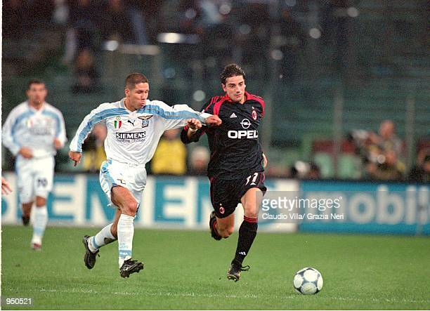 Francesco Coco of AC Milan speeds past Diego Simeone of Lazio during the Italian Serie A match played at the Stadio Olimpico in Rome Italy The match...