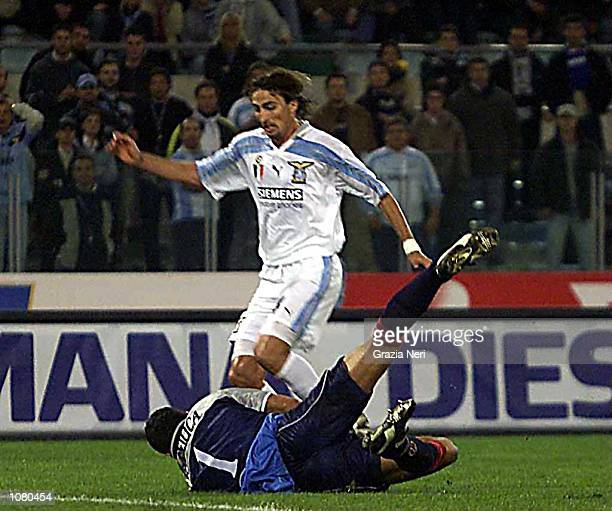 Gianluca Pagliuca of Bologna makes a saves from Dino Baggio of Lazio during the Serie A League Round 5 match between Lazio and Bologna played at the...