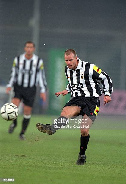 Gianluca Pessotto of Juventus clears the ball during the Italian Serie A match against Lazio played at the Stadio Delle Alpi in Turin Italy The match...