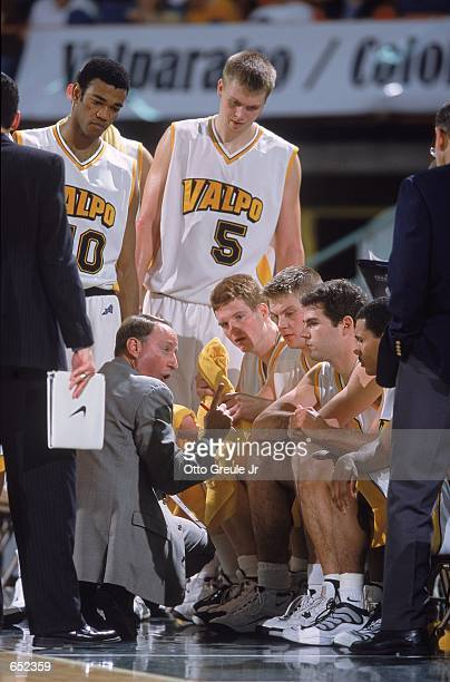 Head Coach Homer Drew of the Valparaiso Crusaders coaches his player on the bench during the Great Alaska Shootout against the Missouri Tigers at the...