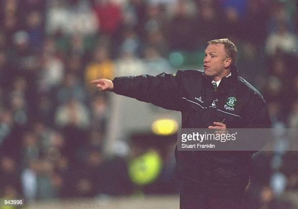 Hibernian manager Alex McLeish looks on during the Scottish Premier League match against Celtic played at Easter Road in Edinburgh Scotland The match...